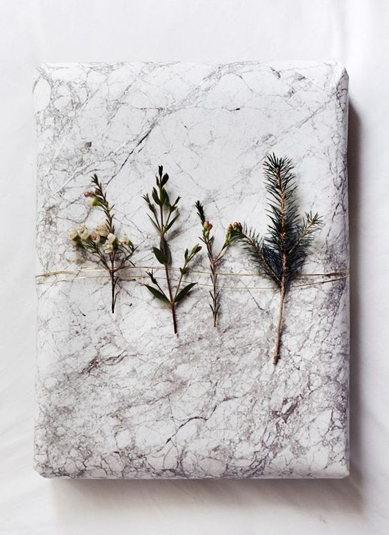 gift wrapping using twigs and flowers